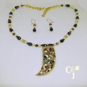 Crystal encrusted claw with black, mauve, and white pearl crystals necklace and earrings set